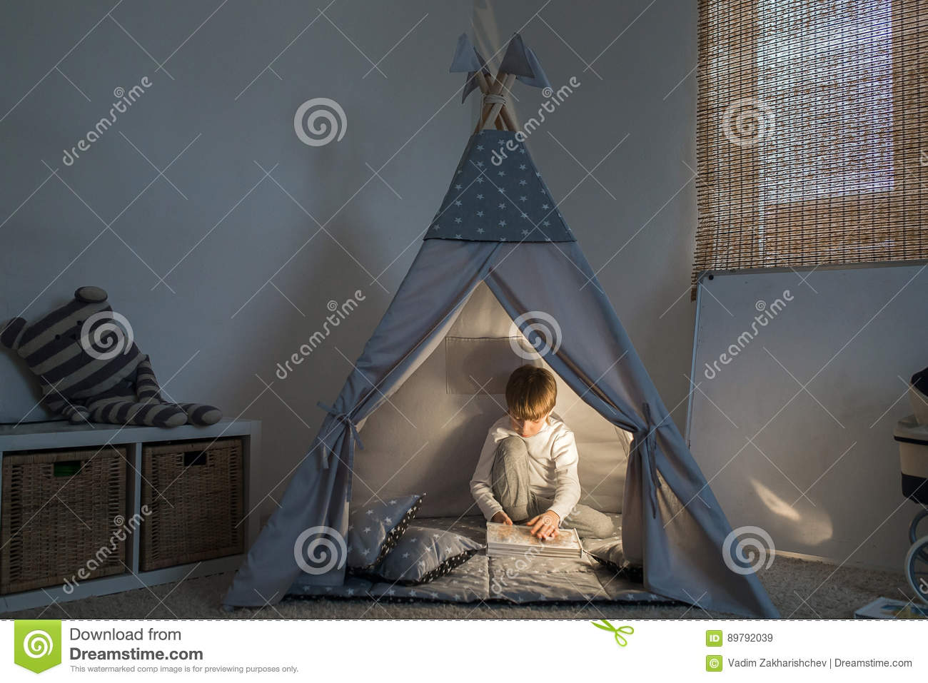 Boy playing in the teepee