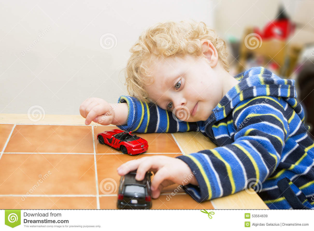 Little Boy With Toy Car : Boy playing with toy cars stock photo image