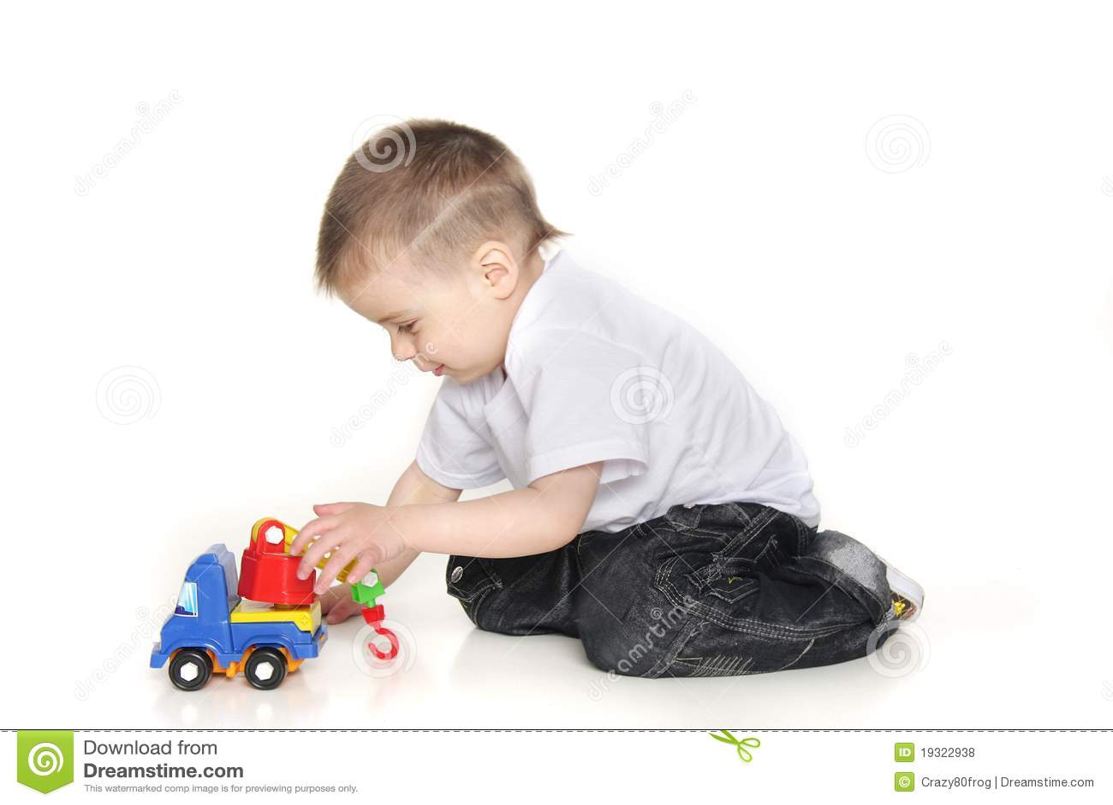 White Boys Toys : Boy playing with toy crane over white royalty free stock