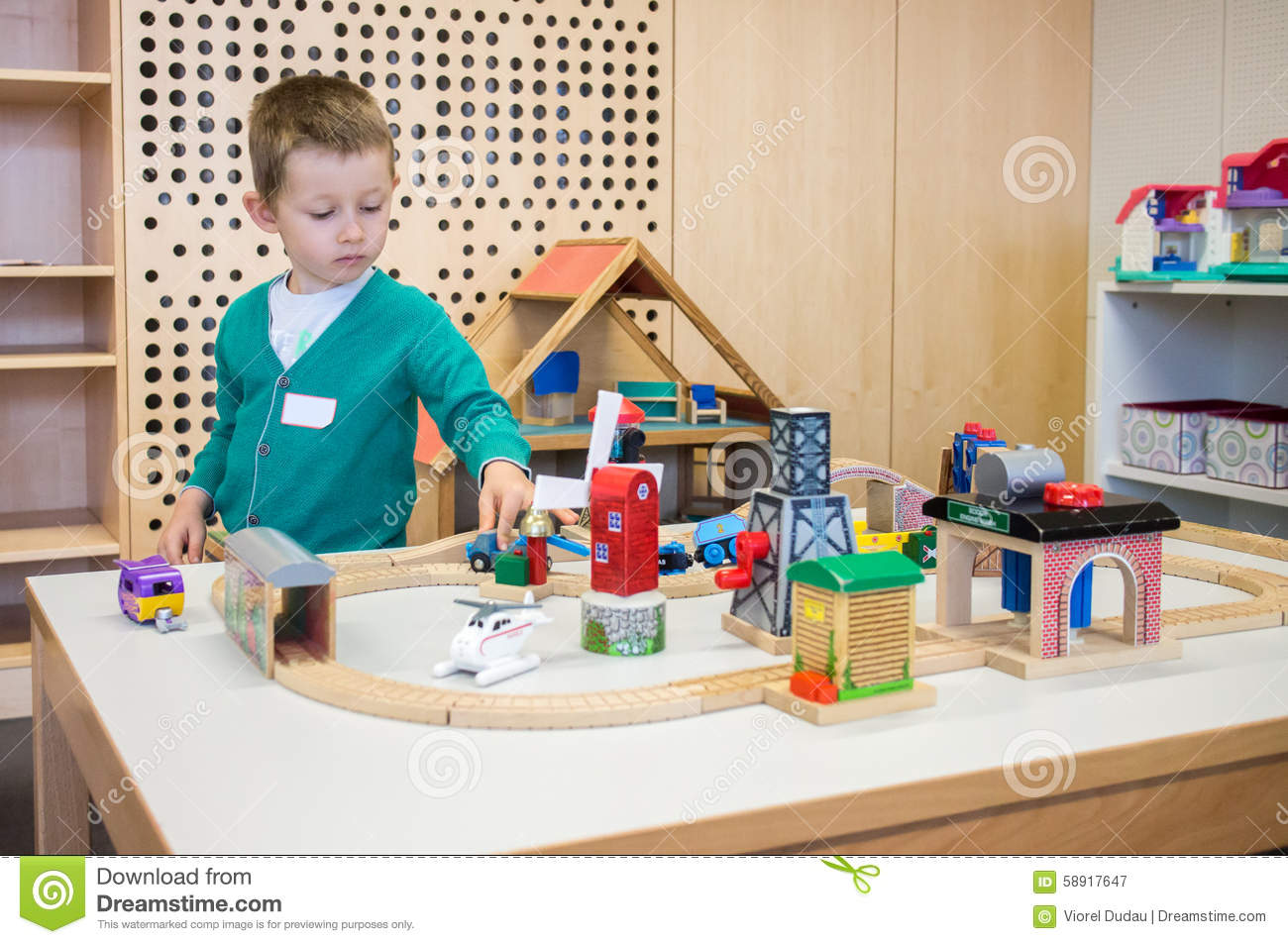 Toys For Boys Kindergarten : Kindergarten boy playing with toys stock image of