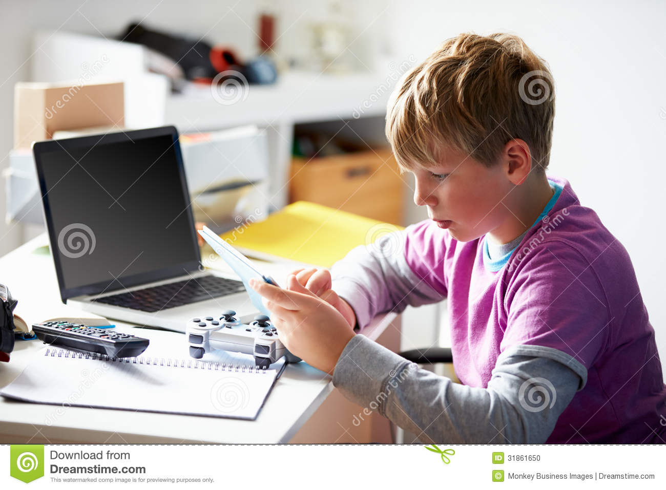 Boy Playing Video Game In Bedroom Stock Photo Image