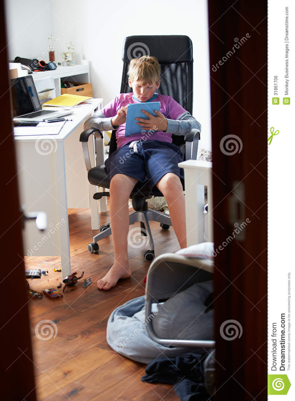 Boy Playing Video Game In Bedroom Stock Photo Image Of