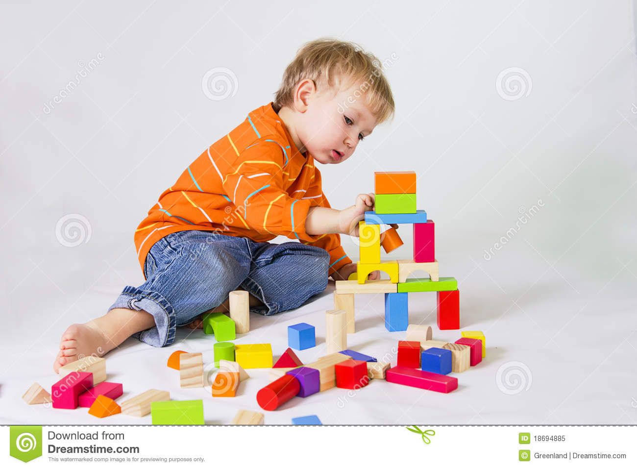 3 Year Old Developmental Toys : Boy playing with wooden blocks royalty free stock photo