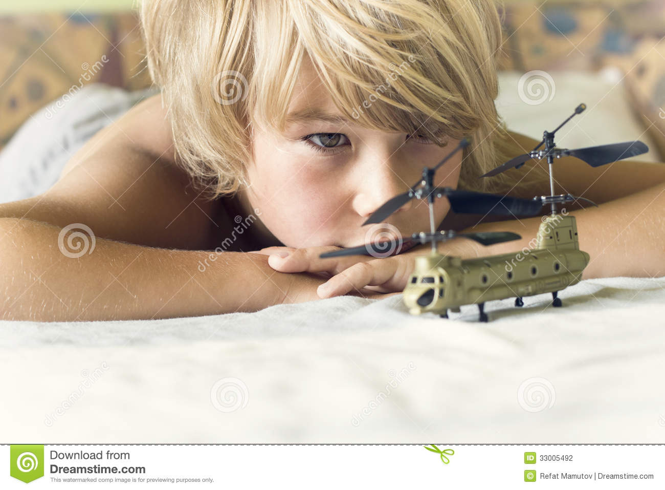 Boy plays with a helicopter