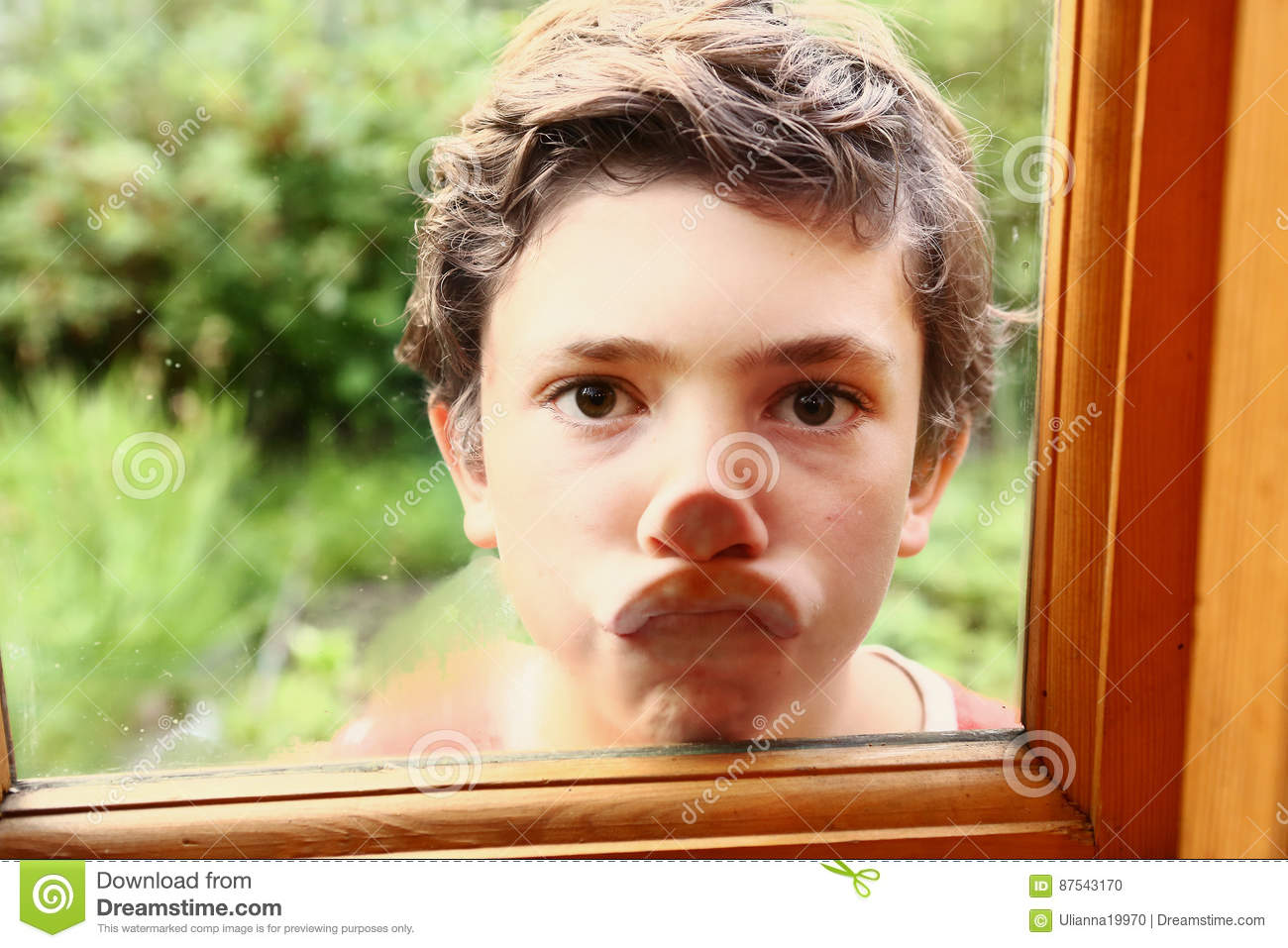 Lips Against The Glass.Boy Press Lips Agaist Window Glass Stock Photo Image Of