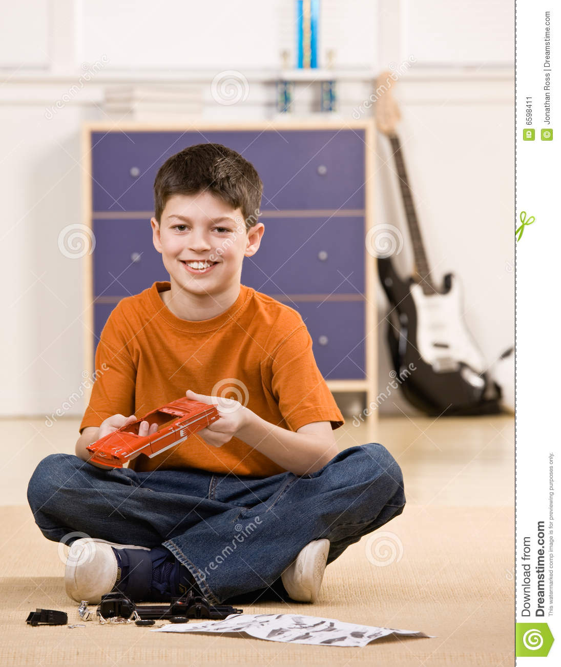 boy putting together parts of small model car stock image image of rh dreamstime com