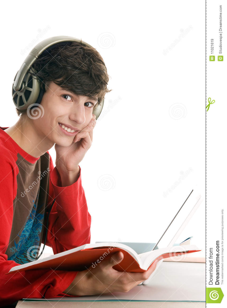 Boy reading book and listening to music
