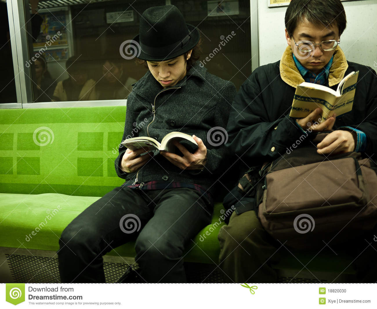 Boy reading in subway