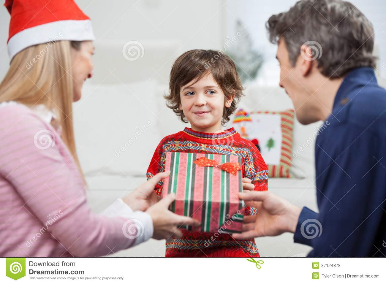 Boy Receiving Christmas Gift From Parents Stock Photo Image Of Parent Celebrate 37124878
