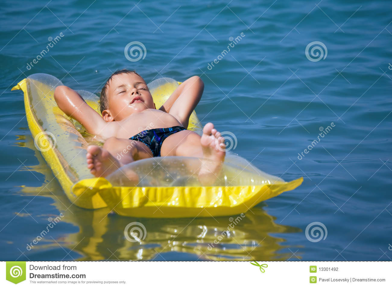 Boy Relaxing On An Inflatable Mattress Stock Photo Image