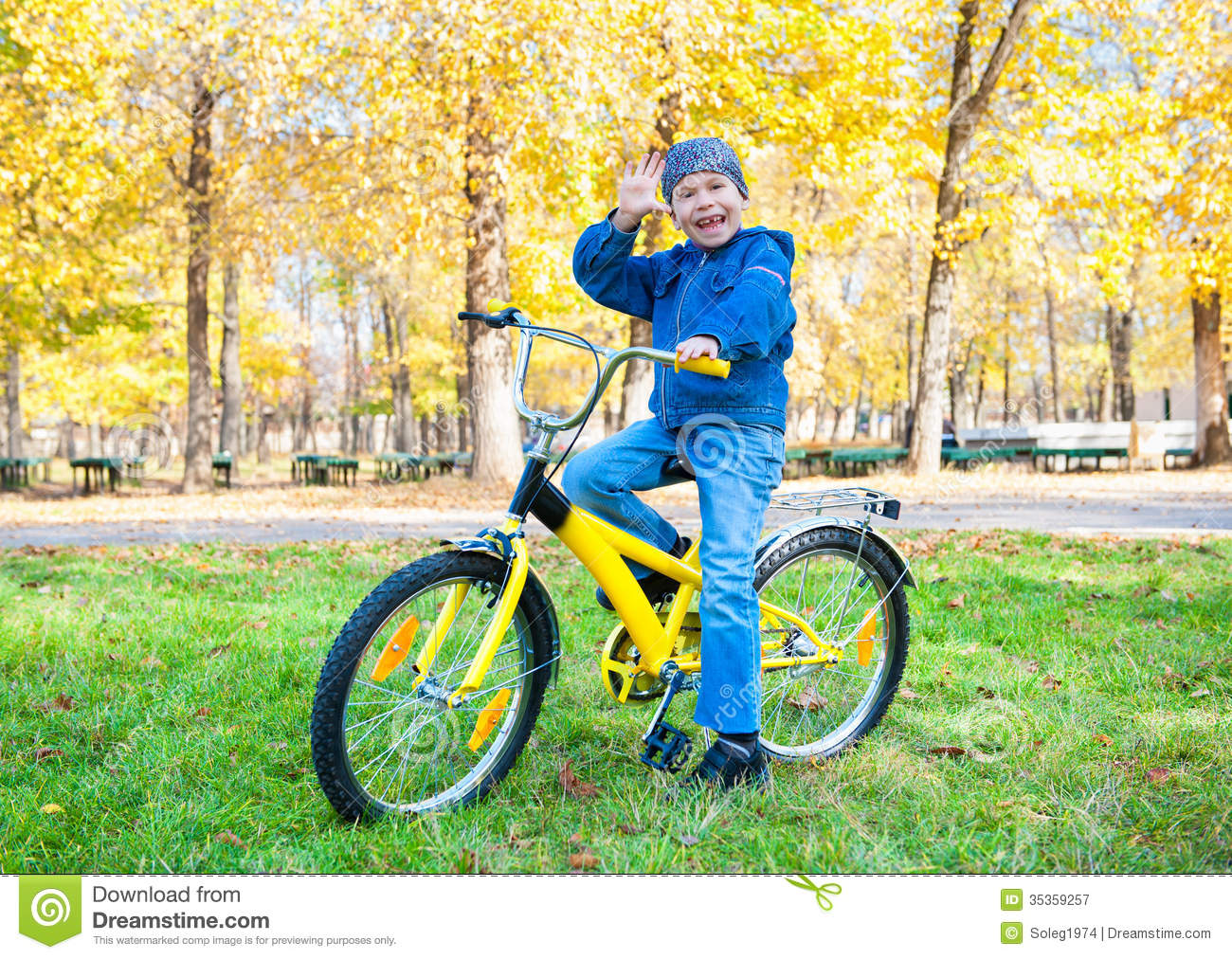 Boy Rides A Bicycle In Park Royalty Free Stock Photography