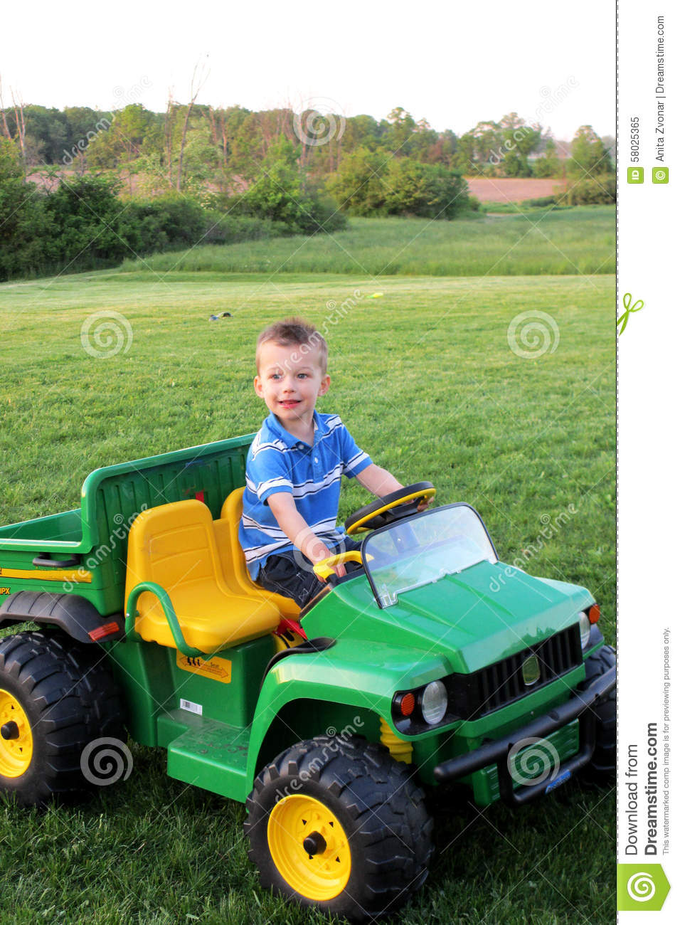 Boy On Tractor : Boy on riding tractor stock image of country
