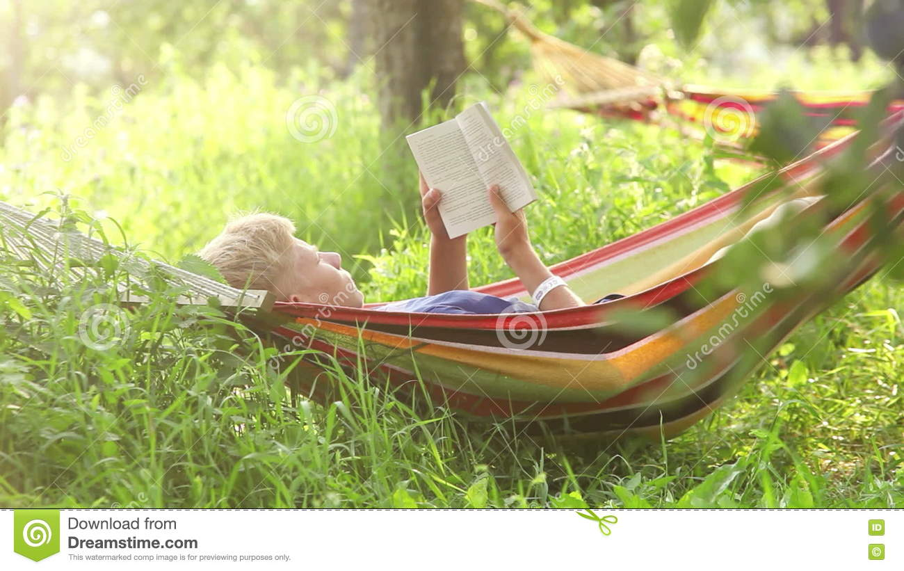 A Boy Rocks Lying In The Hammock And Reads A Book Stock Footage   Video Of  Place, Fresh: 74973082