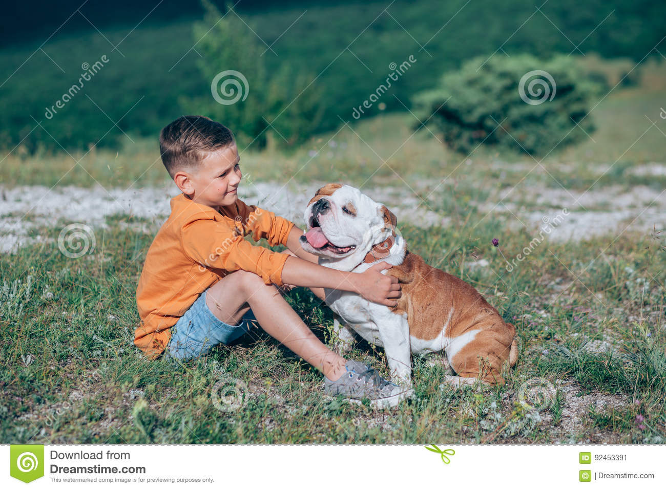 boy-running-field-bull-dog-mountains-924