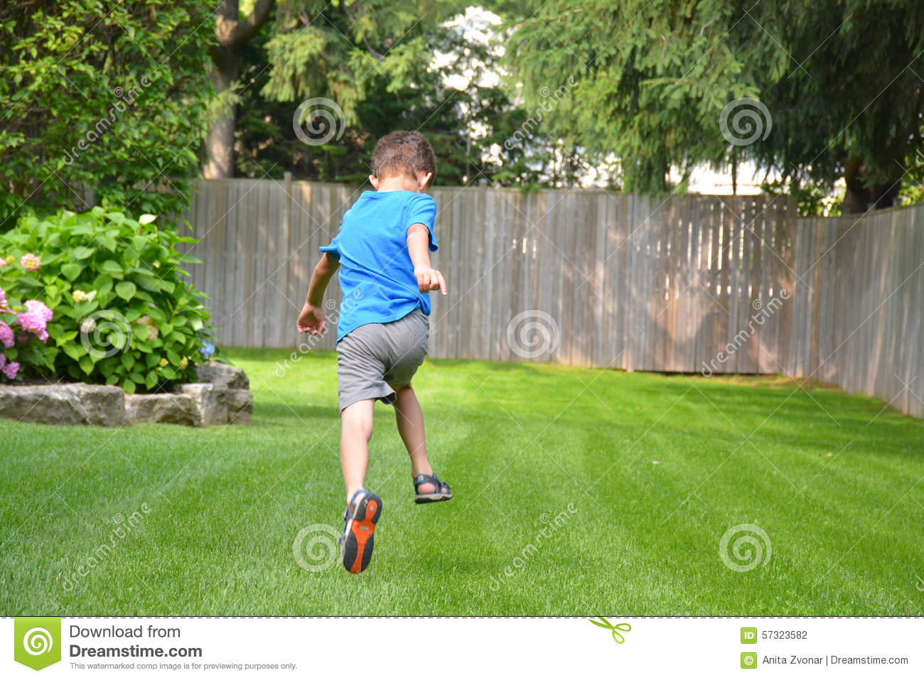 Boy Running Outside In Backyard Stock Photo Image 57323582