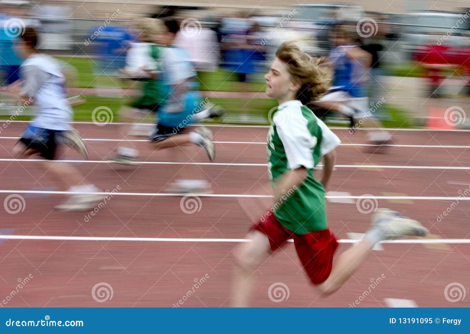 Boy running at track meet