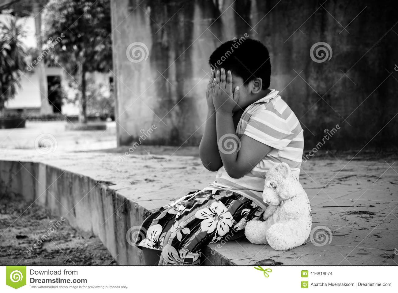Asian boy sad and cry in the park black and white tone