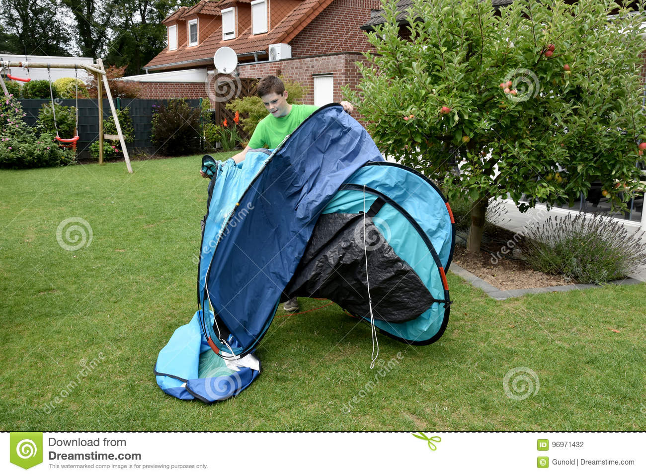 Boy Setting Up A Pop Up Tent Stock Photo - Image of practice