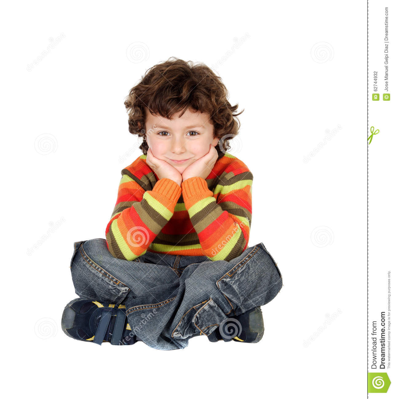 Boy with seven years old sitting on the white floor thinking