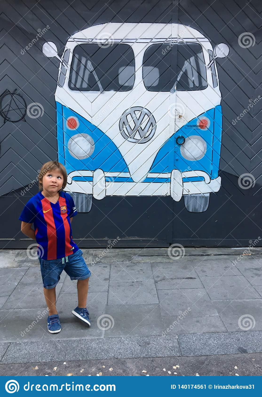 A Boy In The Shape Of A Barcelona Fc Near A Graffiti Painting Of A Volkswagen Bus Painted On A Wall Editorial Photo Image Of German Baby 140174561