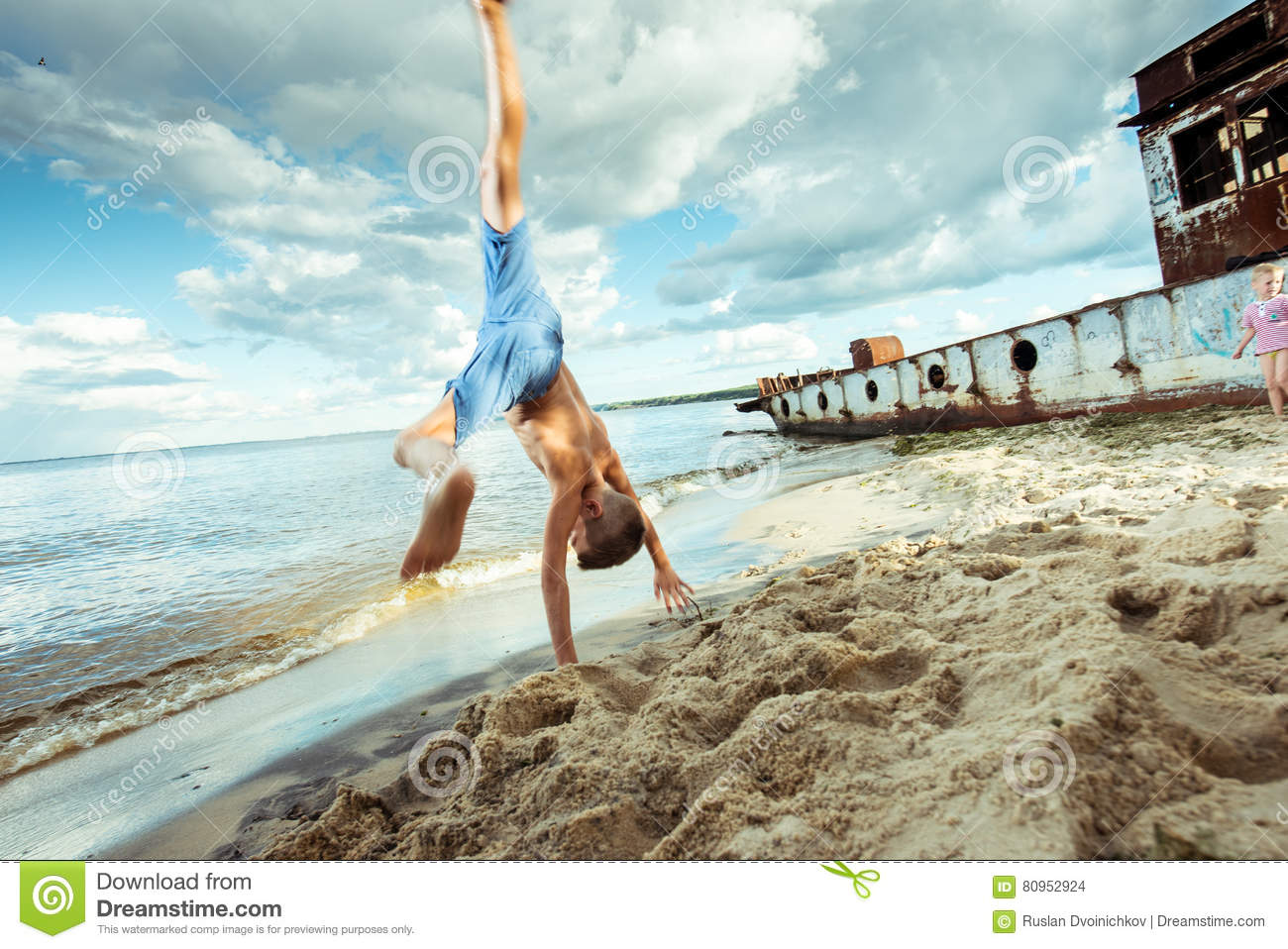 bc55f591a Boy Shorts Is Happy Jumps And Flips On The Beach Stock Photo - Image ...
