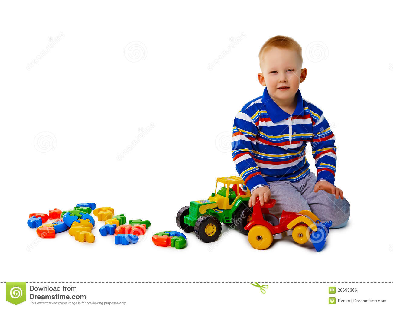 Boy Toys Background : Boy sits on white background with toys royalty free stock