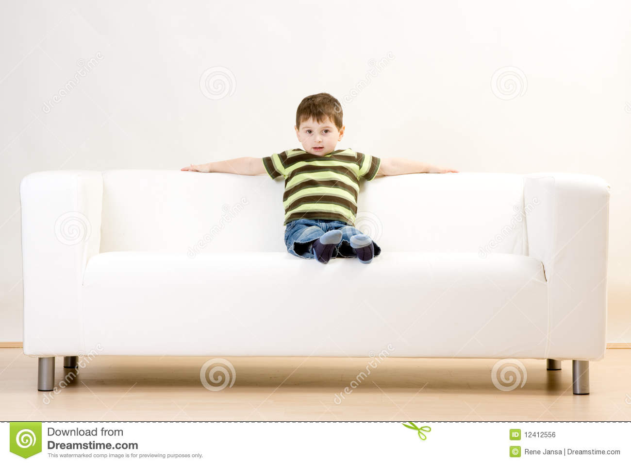 boy sitting on couch royalty free stock image image. Black Bedroom Furniture Sets. Home Design Ideas