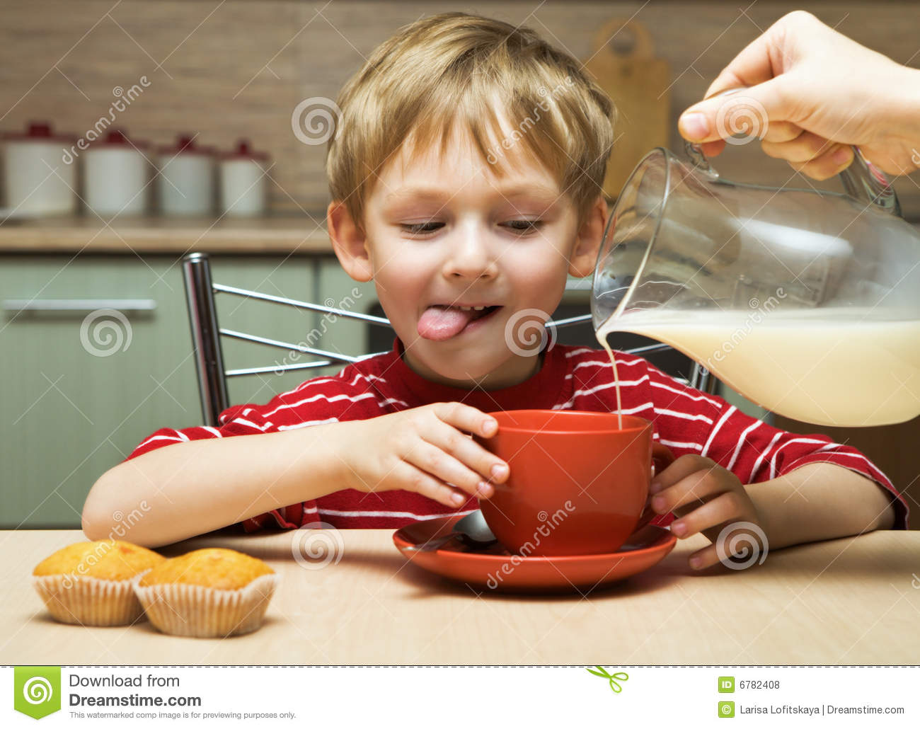 Boy sitting at a table eating breakfast royalty free stock for Eating table