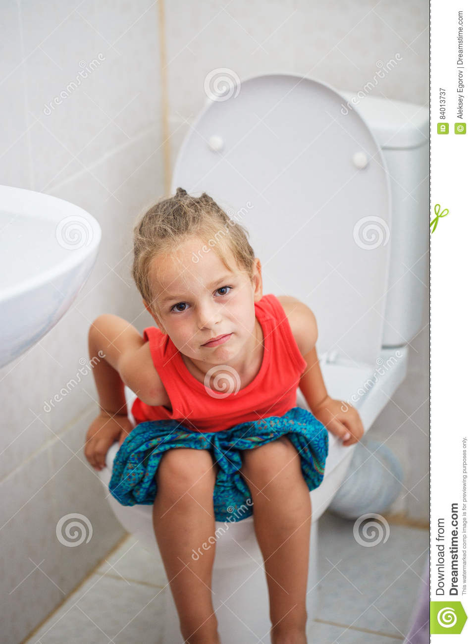 Child With Digital Tablet On Toilet Stock Image - Image of