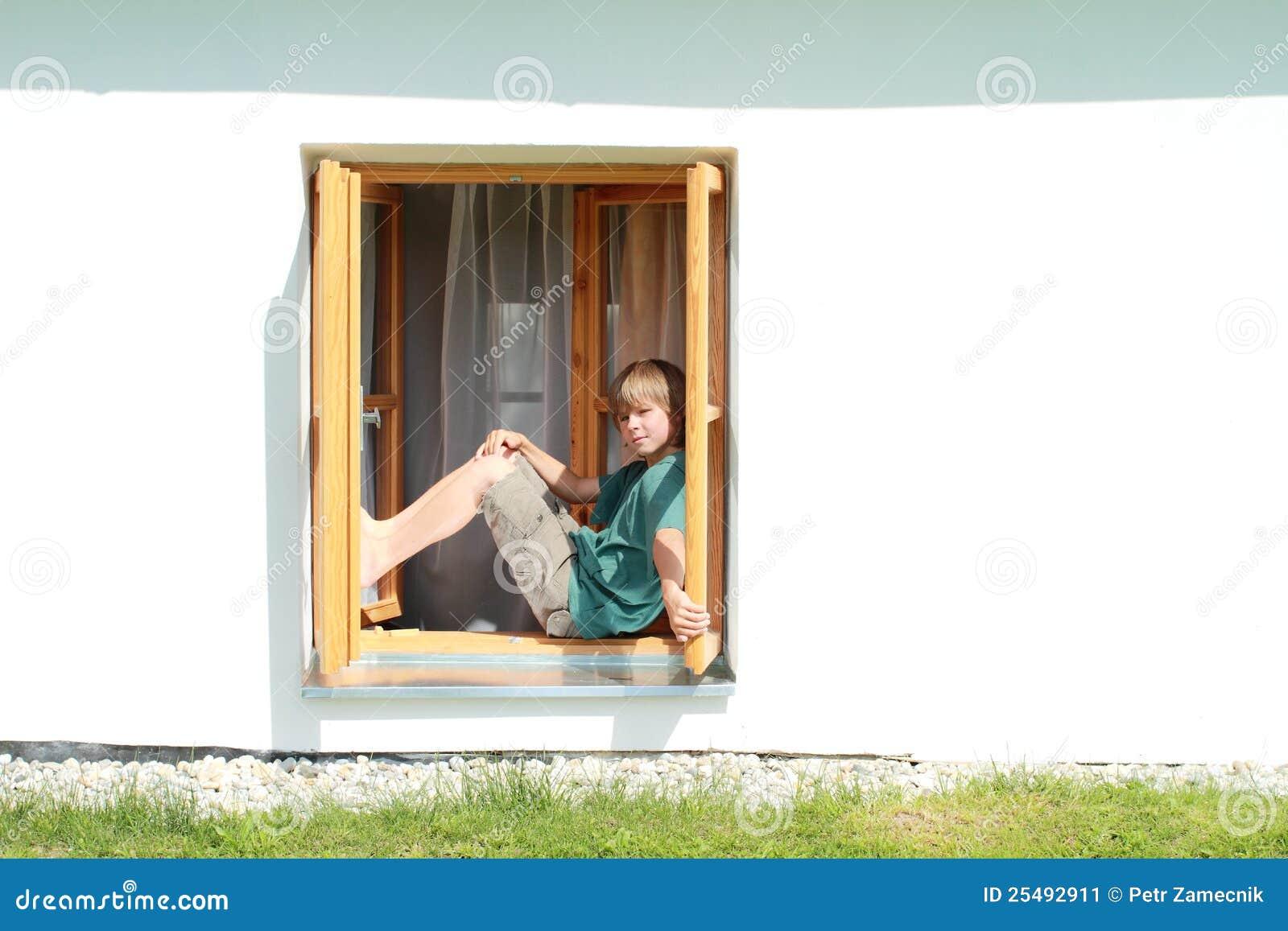 boy sitting on the window stock image image 25492911