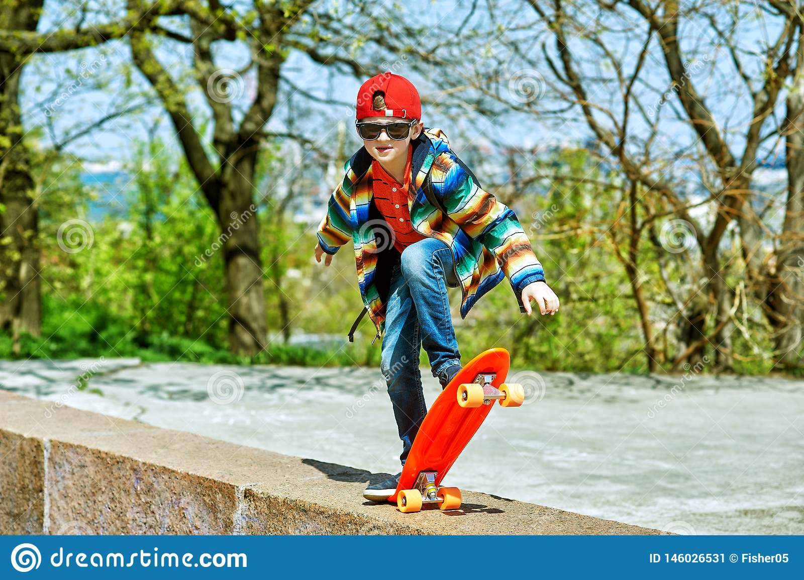 Boy skateboarding in the city Park . The concept of sport and recreation for children