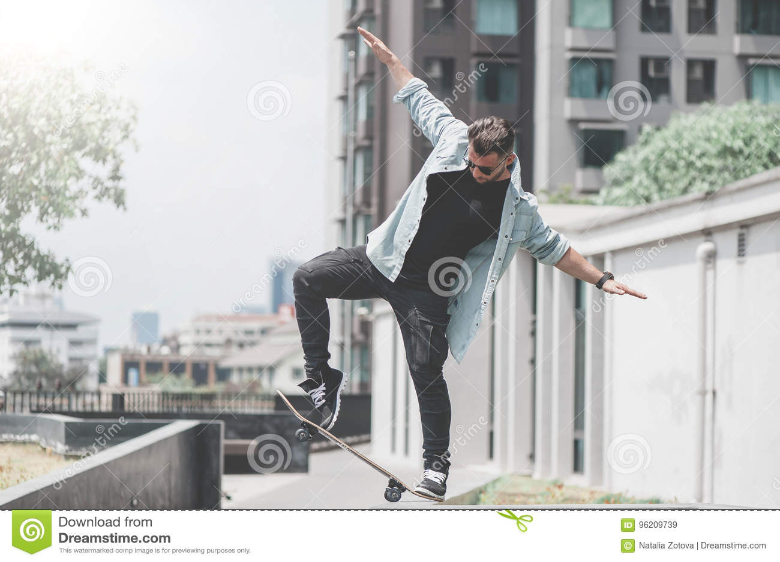 Boy skater is doing stunt at the street