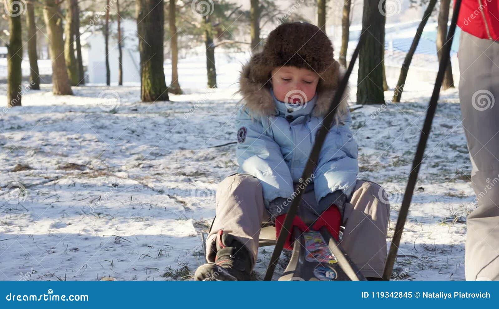 Christmas Vacation Sled.Boy Sledding On Snow Active Fun For Family Christmas Vacation