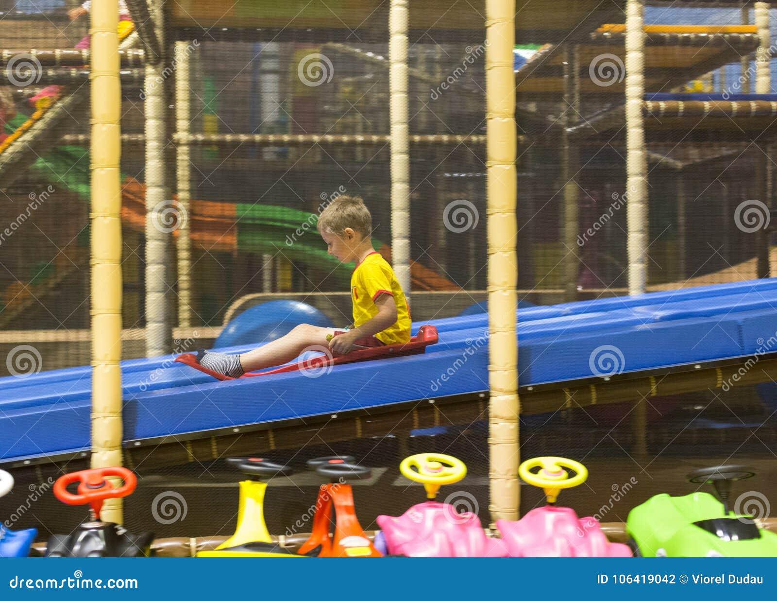 Boy sliding on playground