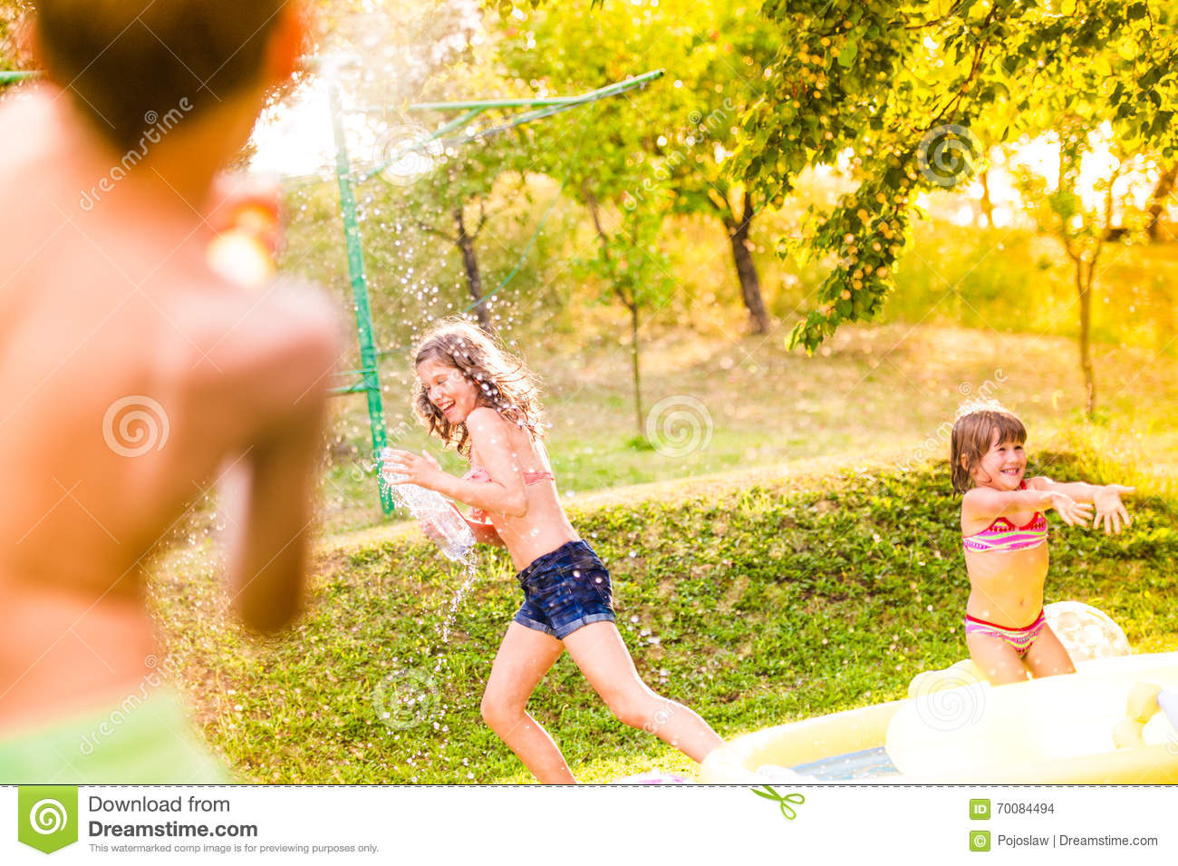 Stunning Boy Splashing Girls With Water Gun In The Garden Stock Photo  With Fair Boy Splashing Girls With Water Gun In The Garden With Breathtaking Sanctuary Spa Covent Garden Mum To Be Also Hilton Garden Inn Fort Washington Pa In Addition Mirror In Garden And Waldorf Covent Garden Afternoon Tea As Well As Astrology Shop Covent Garden Additionally Stanhope Gardens From Dreamstimecom With   Fair Boy Splashing Girls With Water Gun In The Garden Stock Photo  With Breathtaking Boy Splashing Girls With Water Gun In The Garden And Stunning Sanctuary Spa Covent Garden Mum To Be Also Hilton Garden Inn Fort Washington Pa In Addition Mirror In Garden From Dreamstimecom