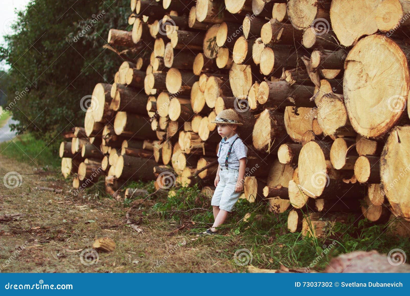 Boy stand near logging