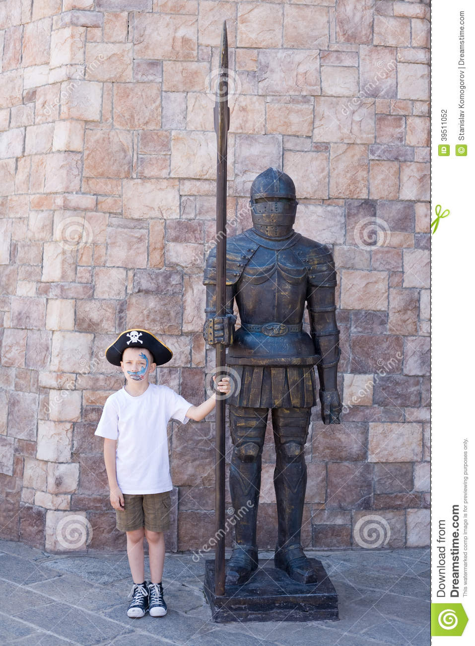 Boy with a statue of a medieval warrior