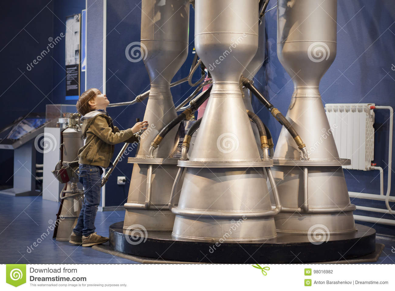 Boy Studies Rocket Engine In Museum  Editorial Photography