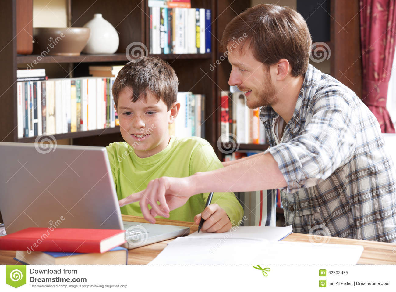 Boy Studying With Home Tutor Stock Photo Image 62802485