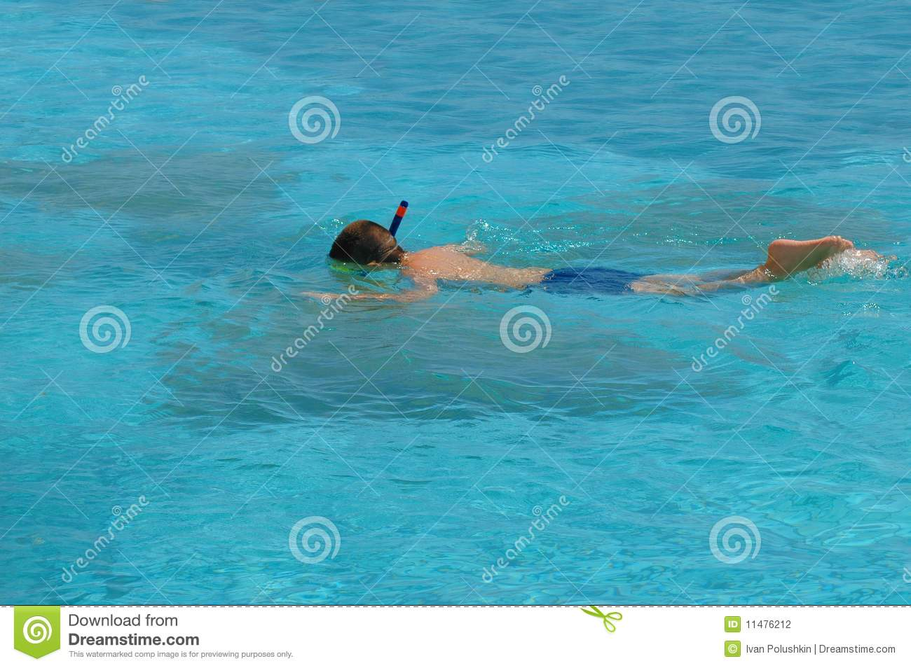Boy swimming with mask