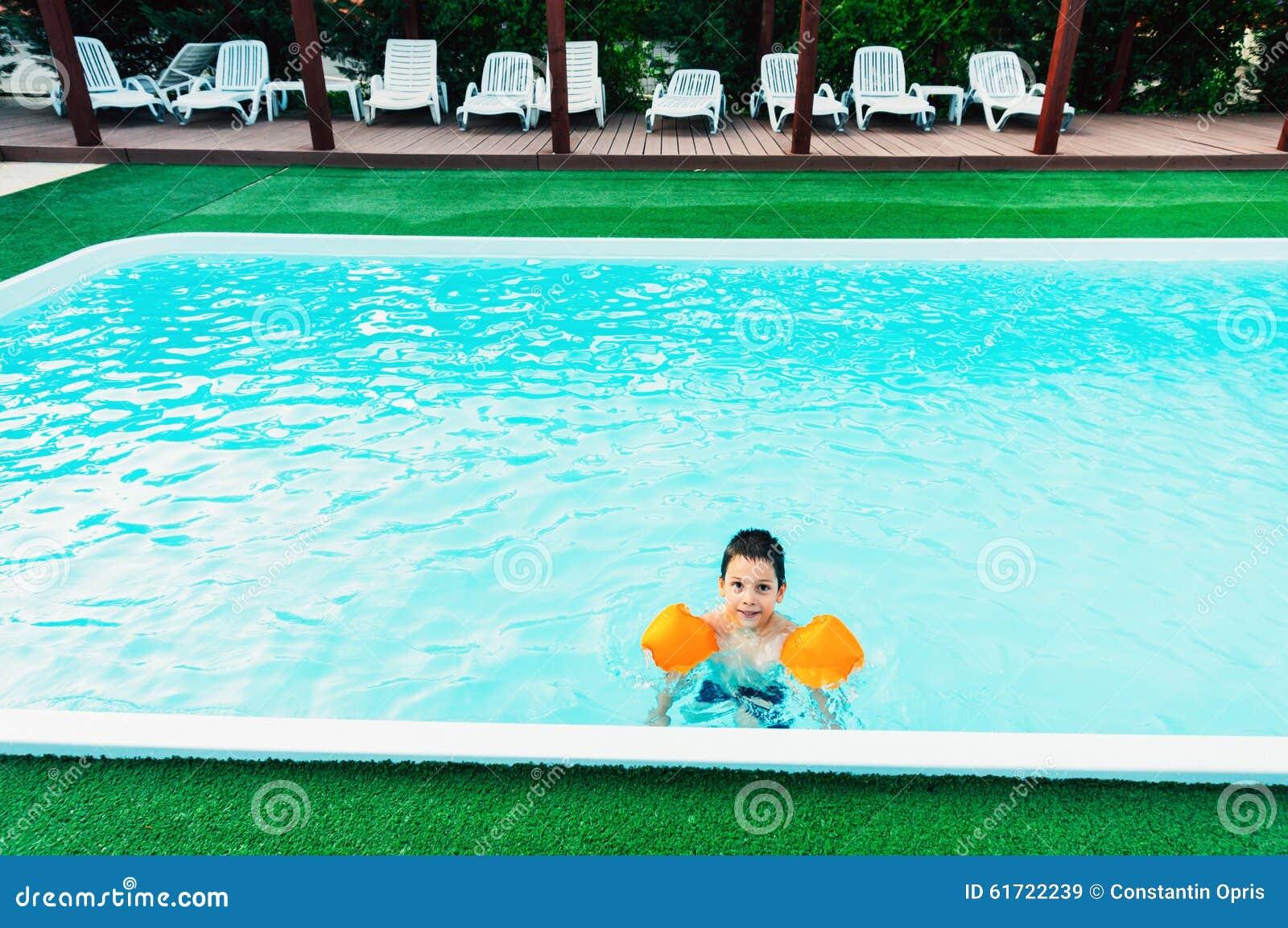 Swimming Pool Wings : Boy in swimming pool stock photo image