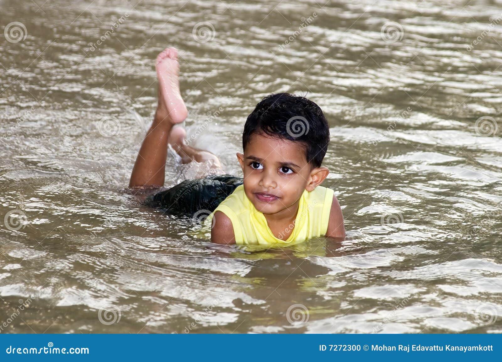 boy swimming river - photo #1