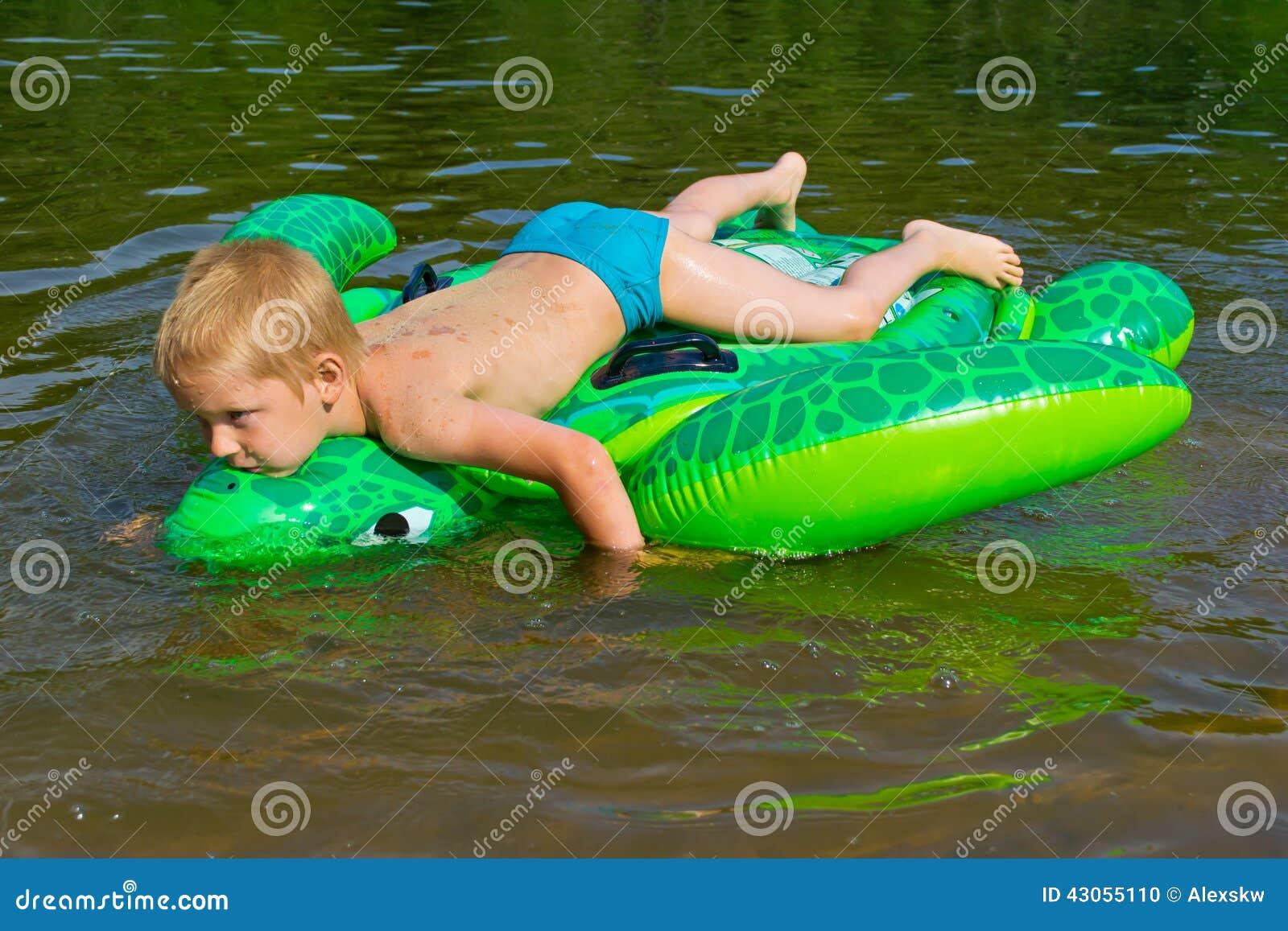 boy swimming river - photo #20