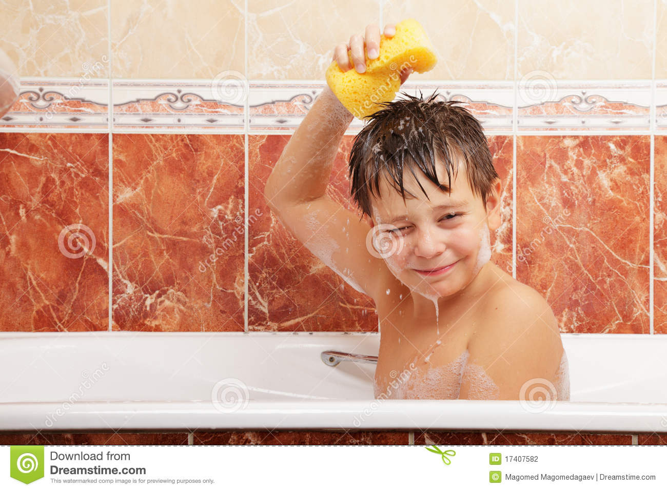 Boy taking bath