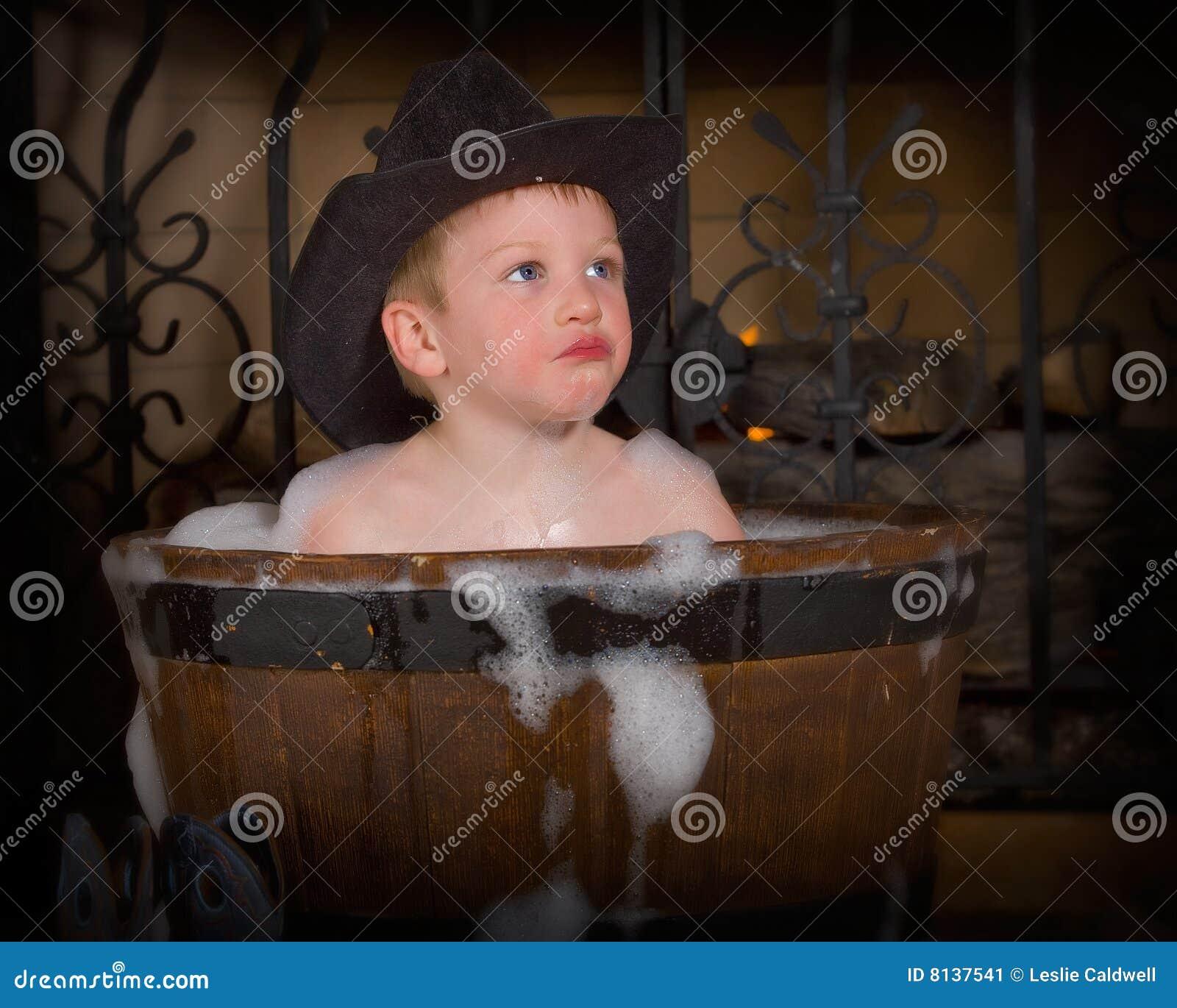 Cute boy taking foamy bath