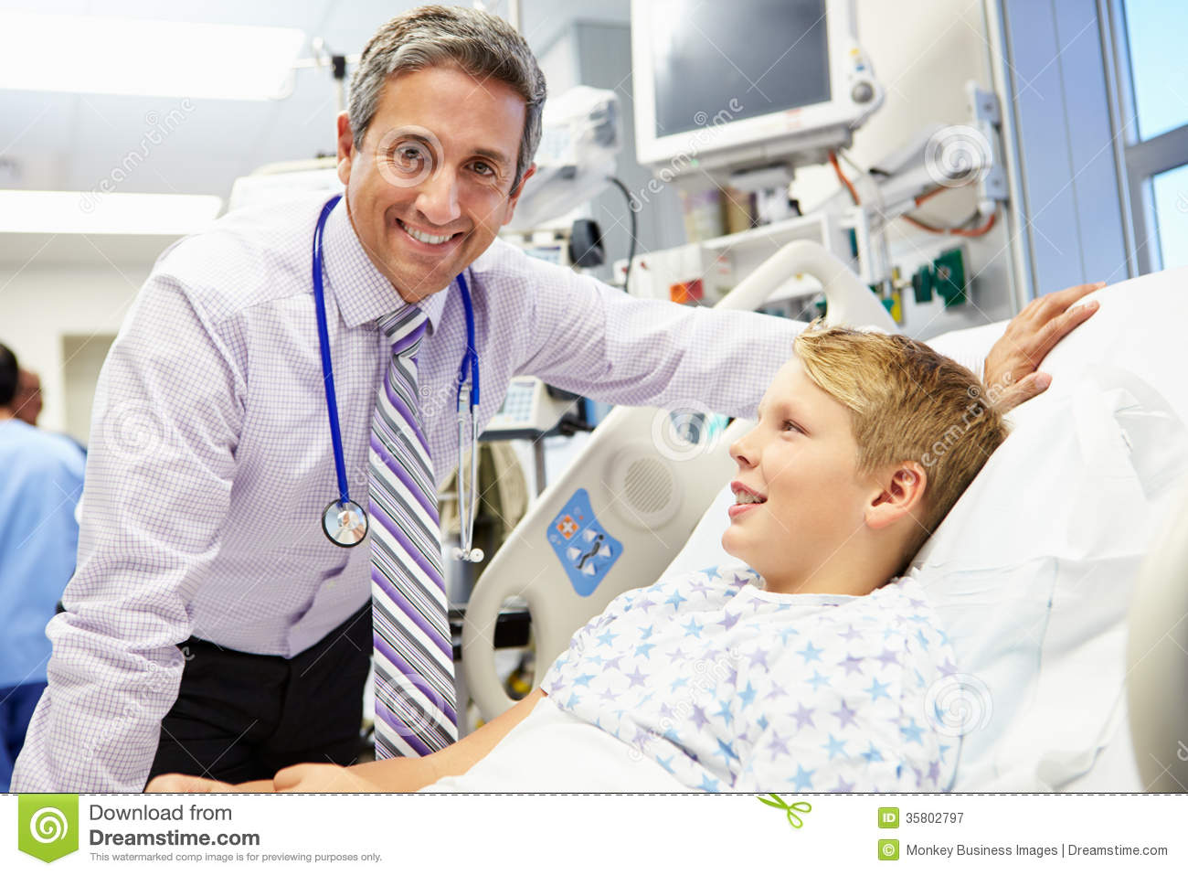 Boy Talking To Male Consultant In Emergency Room Stock