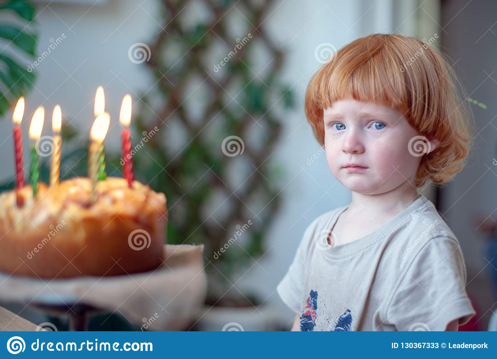 Boy With Tears In His Eyes Can Not Blow Out The Candles On Cake