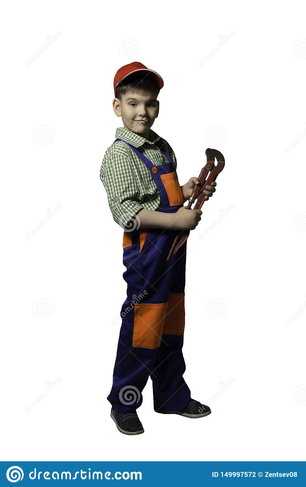 Boy, teenager with tools for repair and construction, in overalls and helmet, isolated.