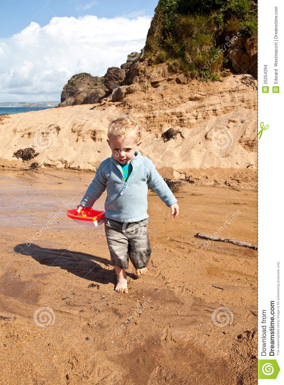 Lillle Boy Toys Boats : Boy with a toy boat stock images image