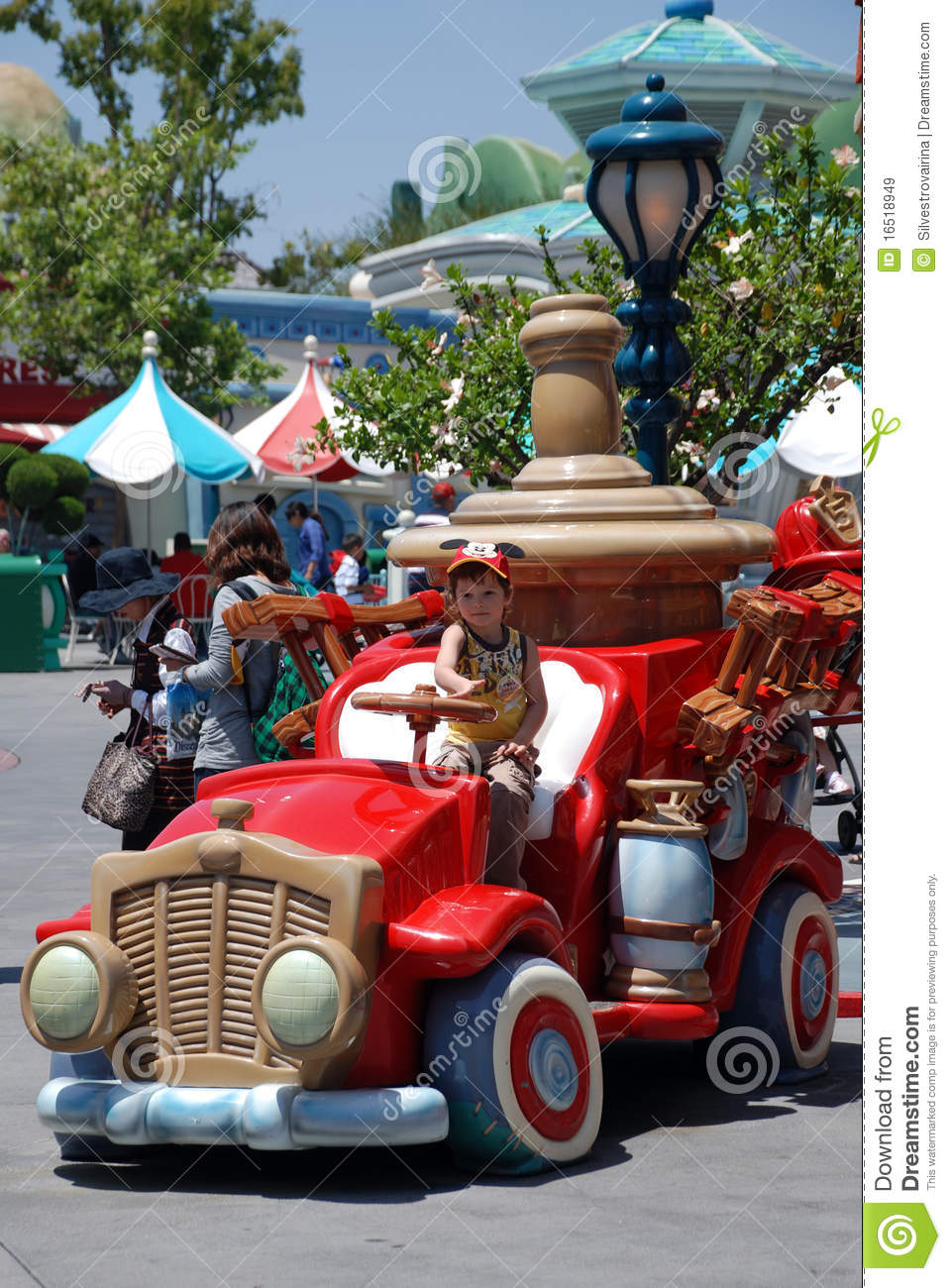 Boy in the toy car in mickey s toontown